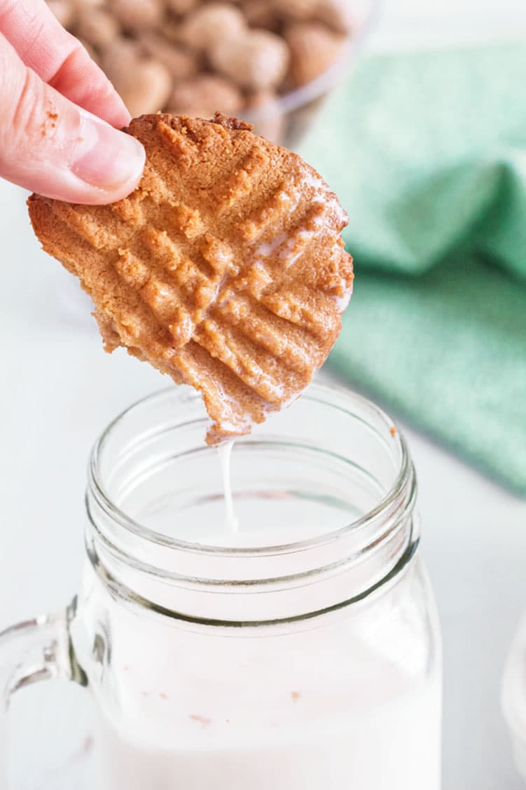 Dunking a 3-ingredient peanut butter cookie.