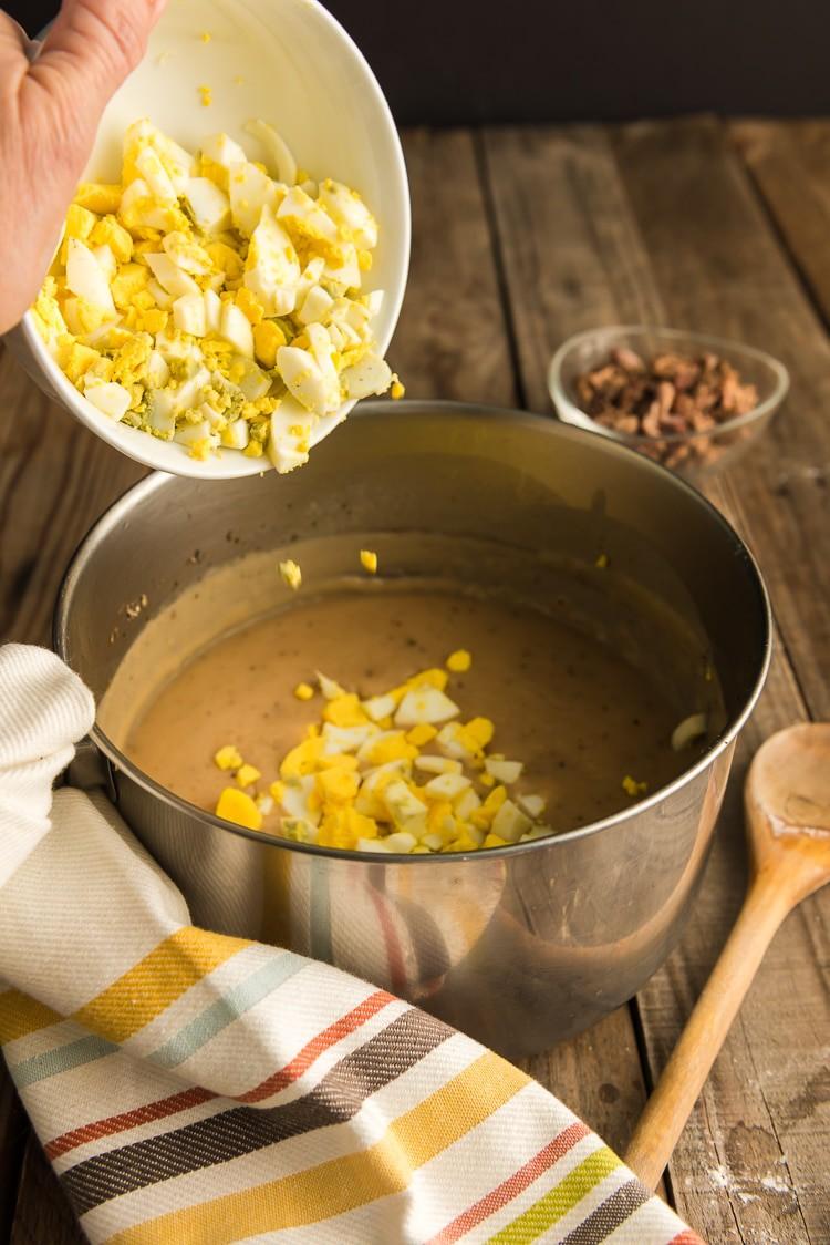 Adding eggs to make giblet gravy.