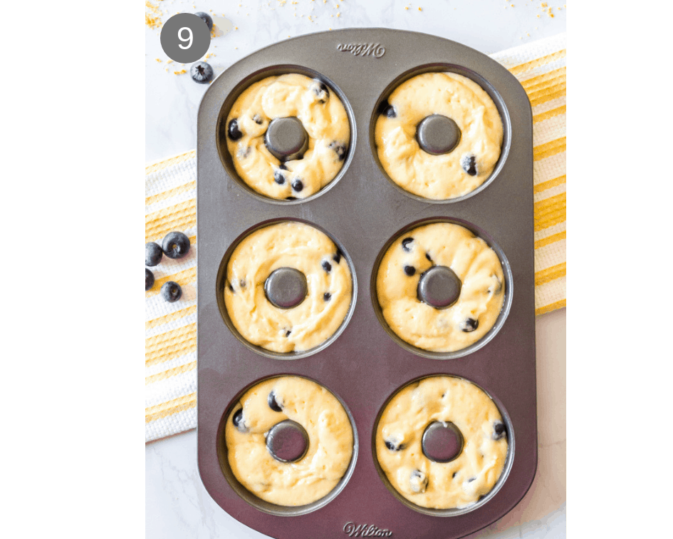 Donut baking pan with unbaked donut batter.