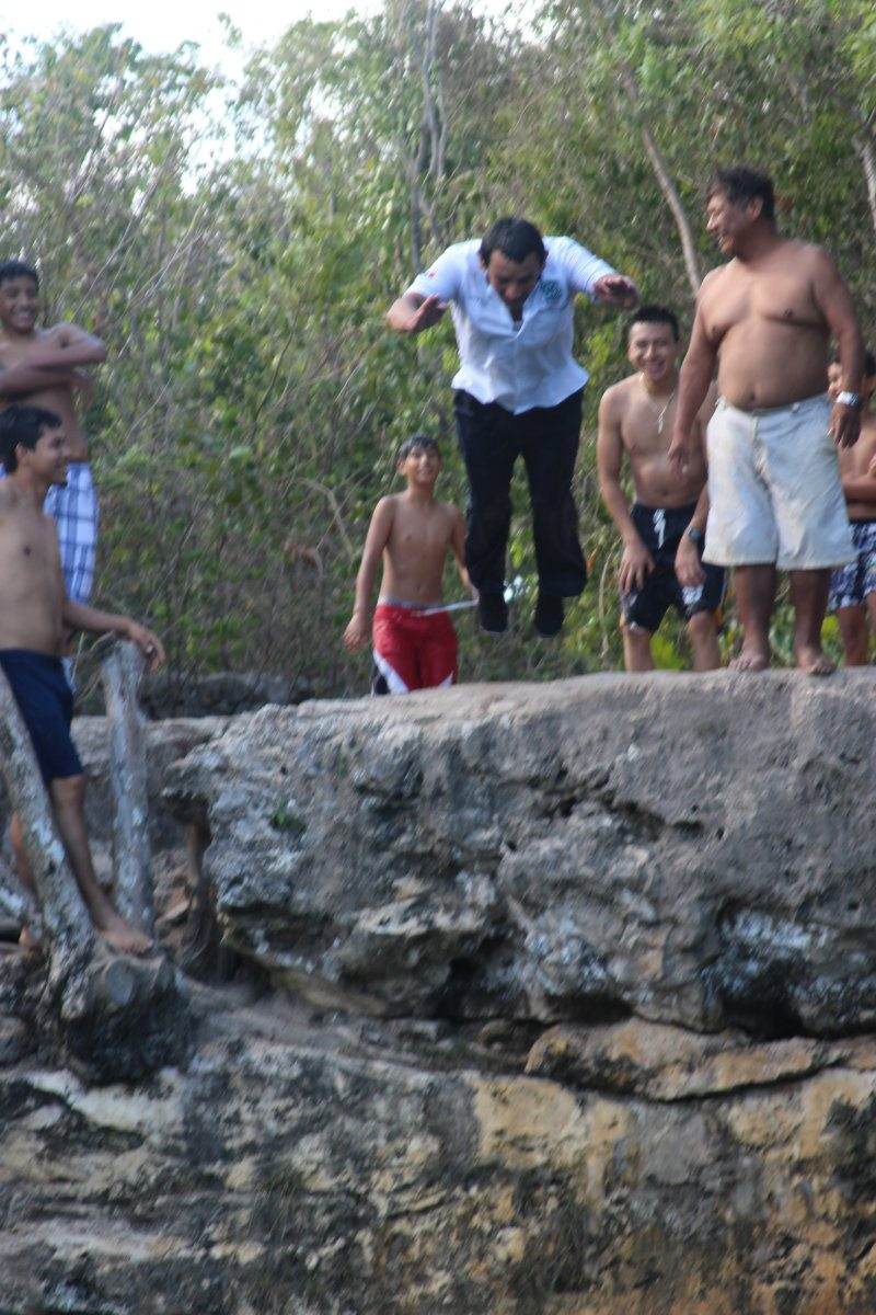 People jumping in the cenote azul