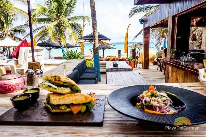 a Mediterranean-style baguette and a fresh ceviche at inti beach club