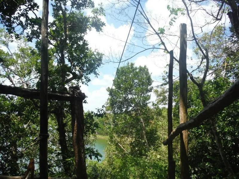zip line over the lagoon at punta laguna