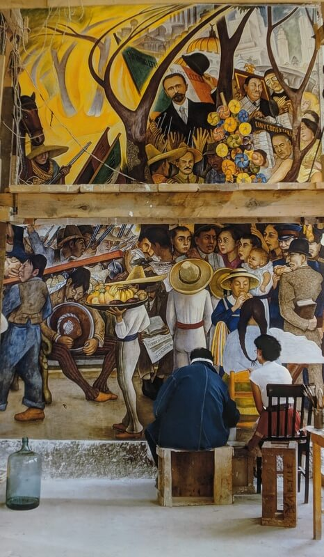 Diego Rivera painting a mural in Mexico City