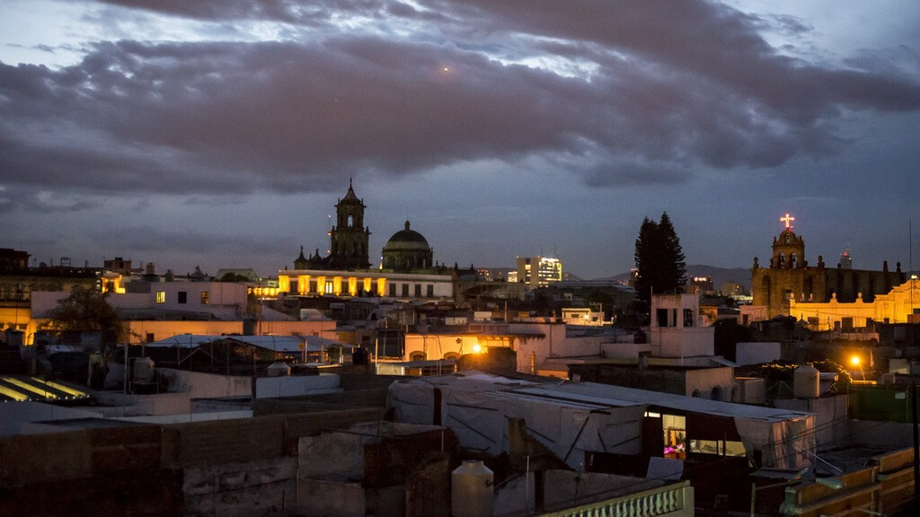 Sunset at Casa Pedro Loza with churches in the skyline, Mexican wedding toast