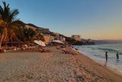 Puerto Vallarta Playa los Muertos beach and pier at sunset