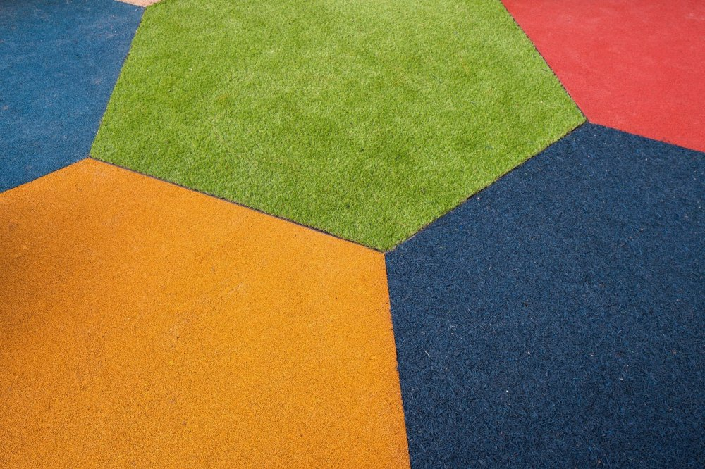 playcubed, artificial grass for playgrounds Kent, play surface, Valley Provincial, bespoke garden design, bespoke playground equipment, custom playground surfacing, playground landscaping,