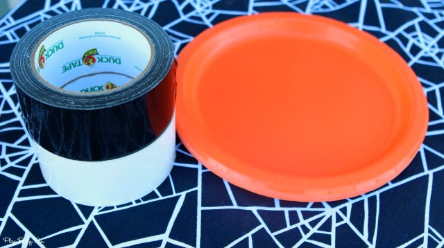 Keep your kids busy making these fun Halloween spiderweb plates then use them as the perfect Halloween party supplies