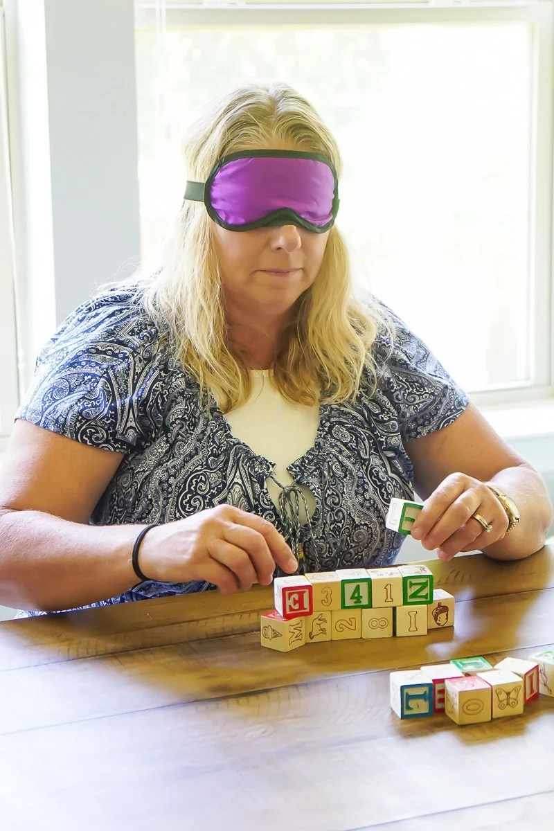 Blindfolded blocking is one of the best baby shower games