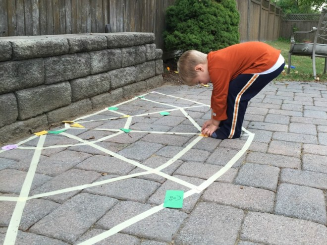 Practice shapes with this spider web shape game!