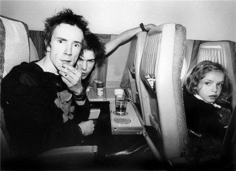 (Photo: Bob Gruen -Johnny Rotten & Sid Vicious on a Plane - London to Brussels - 1977)