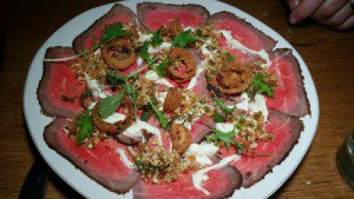 Charcoal Grilled Beef Carpaccio with stracciatella, cauliflower and crispy shallots