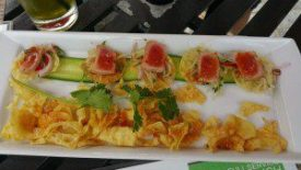 Spicy Tuna Tacos (green papaya, tomatillo, kaffir lime lecrives, onions, thai sweet chili sauce)