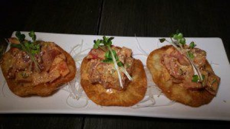 Tuna Tostada (tuna, tomato, masago, scallion with spicy sauce on fried wonton skin)