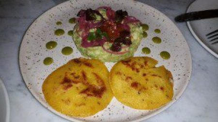Avocado, pupusa, cured egg yolk, pickled red onion