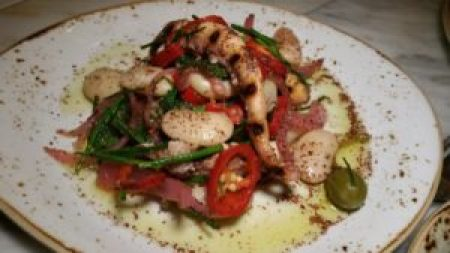 Charred Octopus, butter beans, pickled onions, fresno chilies