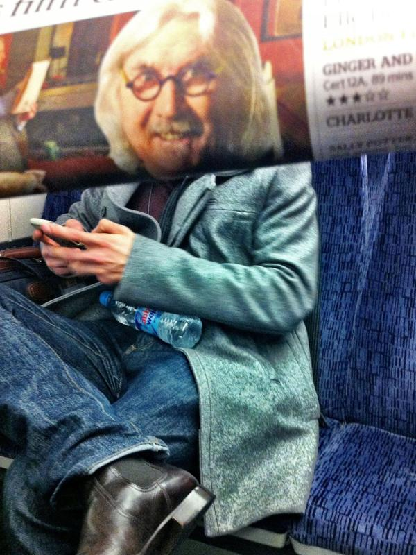Bored Commuter Places Newspaper Heads on Peoples Bodies  Pleated Jeans