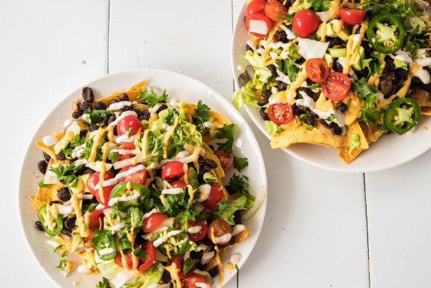 Gluten free vegan black bean nachos with homemade queso