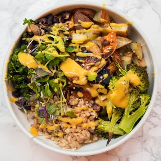 vegan farro sweet potato broccoli bowl with queso and coconut bacon