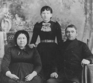 Johann Funk with his third wife Louise and their foster daughter Justina Klassen, ca 1890. Funk was more open to the evangelists who came to the West Reserve in the 1880s than many of his parishioners, precipitating a split in his church that gave rise to the larger Sommerfelder and smaller Bergthaler Gemeinden.   Photo Credit: Gameo, original at the Mennonite Heritage Centre: 205.1