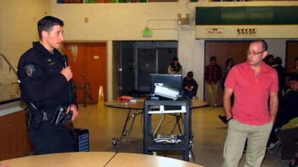Jason and an officer from the Federal Way Police Dept. present to high school students for TADD.