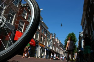 Bicycle wheel and a pedestrian on a road before an accident