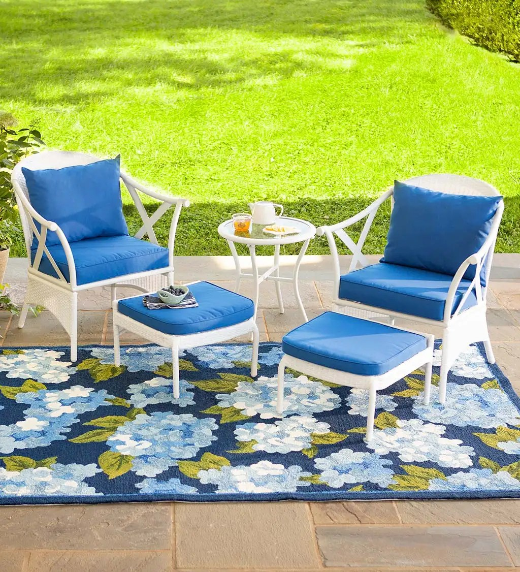 five piece white wicker patio furniture set with cushions