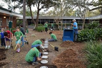 students-adults-working-to-create-outdoor-classroom