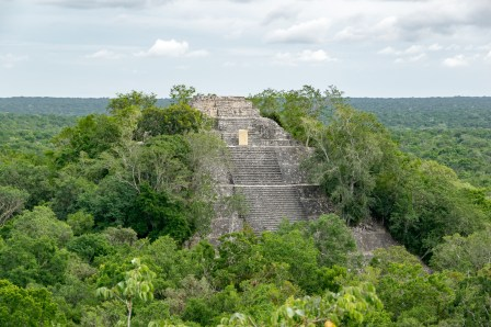 Lost in the Mexican rainforest, you can find the ancient town of Calakmul