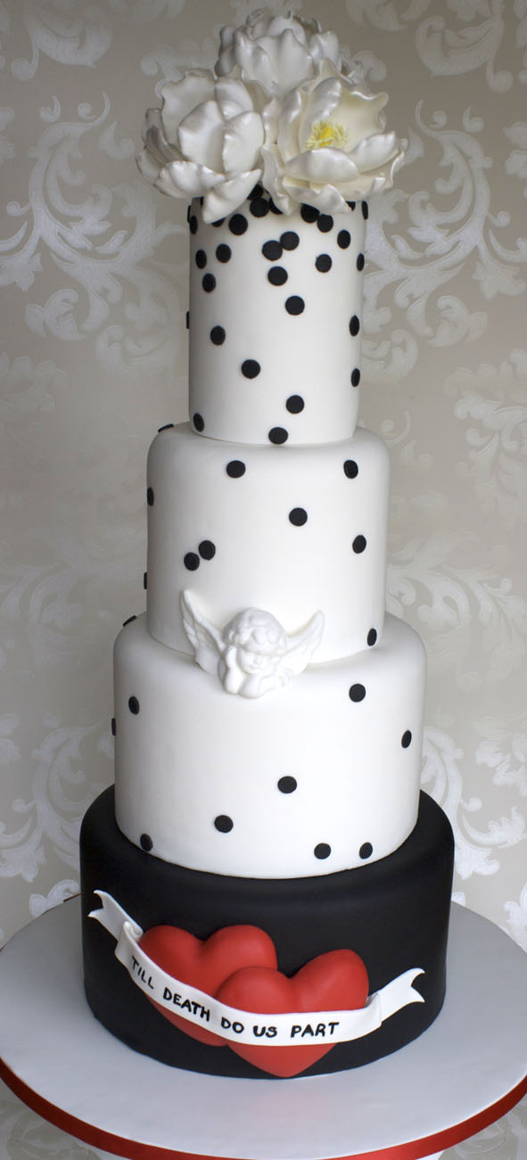 White and black wedding cake with polka dots, mini cupid and shimmer peonies