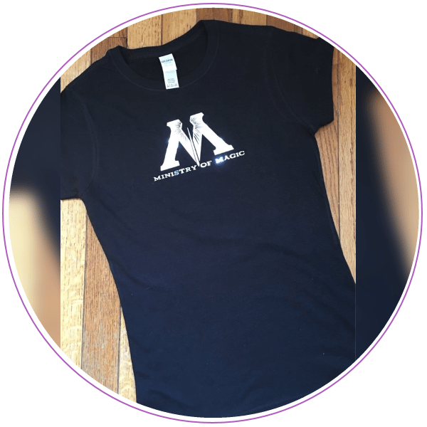 Navy blue t-shirt with Ministry of Magic logo