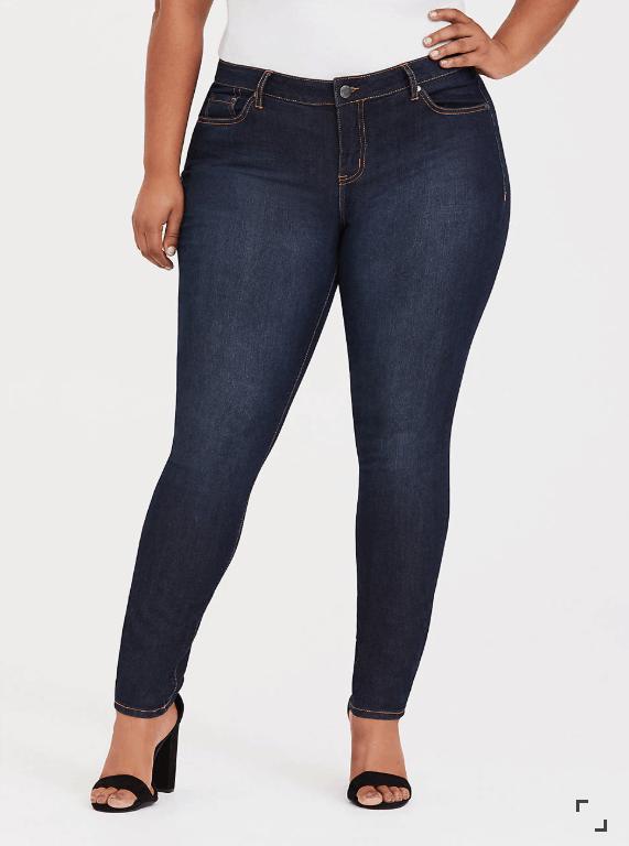 Woman wearing dark wash tight jeans