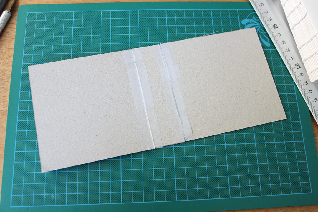 Pasting the pieces of cardboard together with some tape