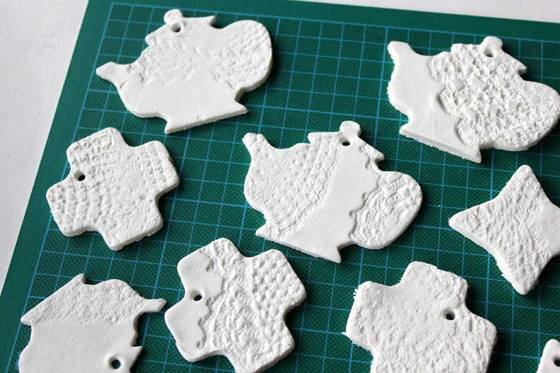 Let the paper clay ornaments dry after cutting them out