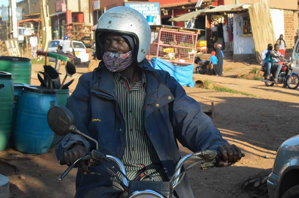 Nassur Sebakali, a boda boda driver, waits for customers in Kiwanga village in late August. The national lockdown severely impacted his business and made it difficult to support his family.