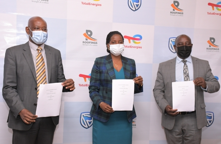 Total Uganda, Stanbic Bank and Roofings Chief Executives shortly after signing partnership