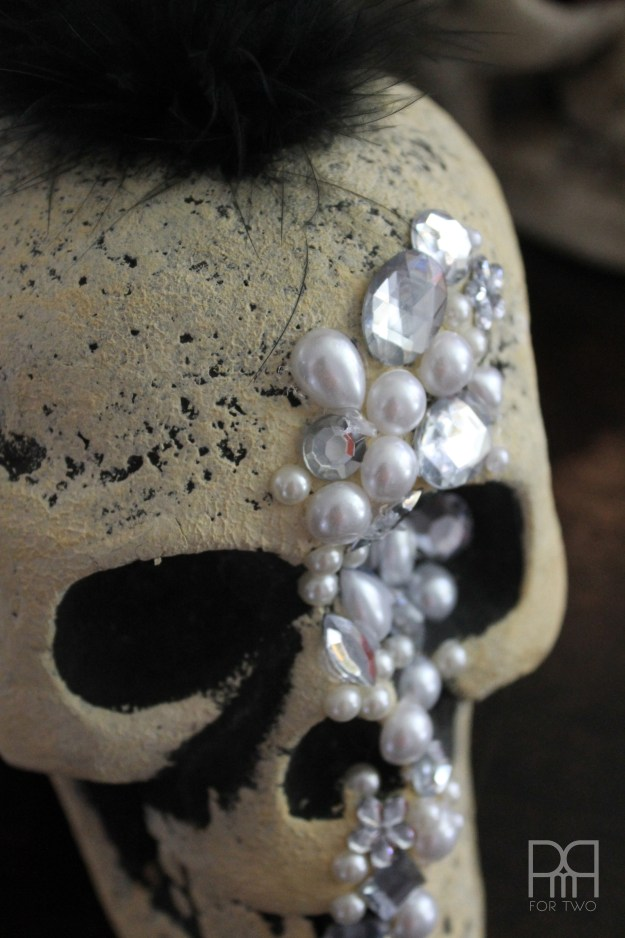 Make your own glam DIY Jewelled Skull for under 6$ using supplies from the dollar store and a little bit of hot glue.