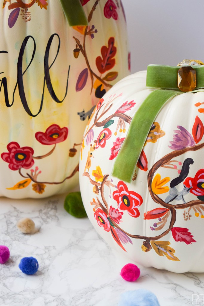 close-up picture of two rifle paper co inspired fall pumpkins