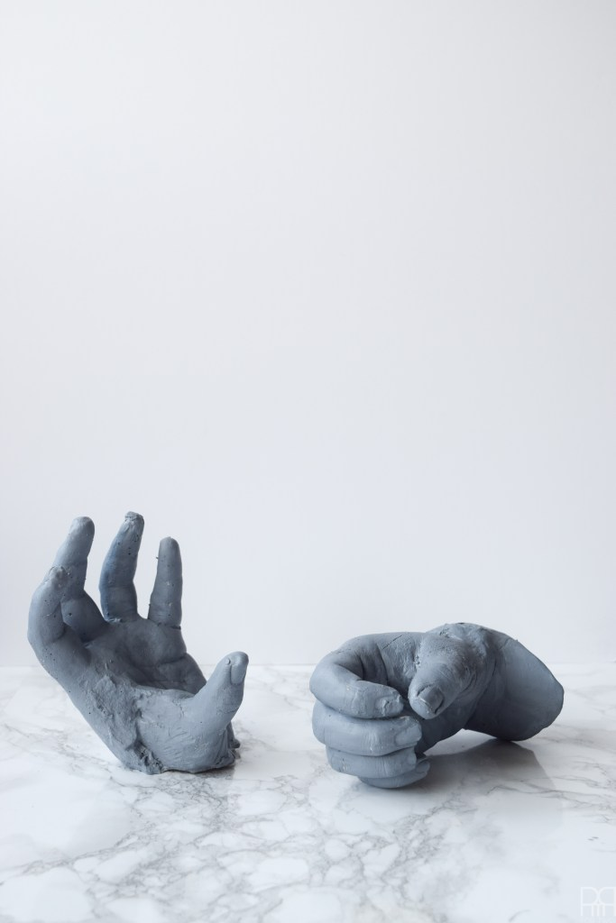 DIY Grave Robber Hands for spooky Halloween decor. Using plaster hand casts, paint, and little gemstones you can make some spooky things!
