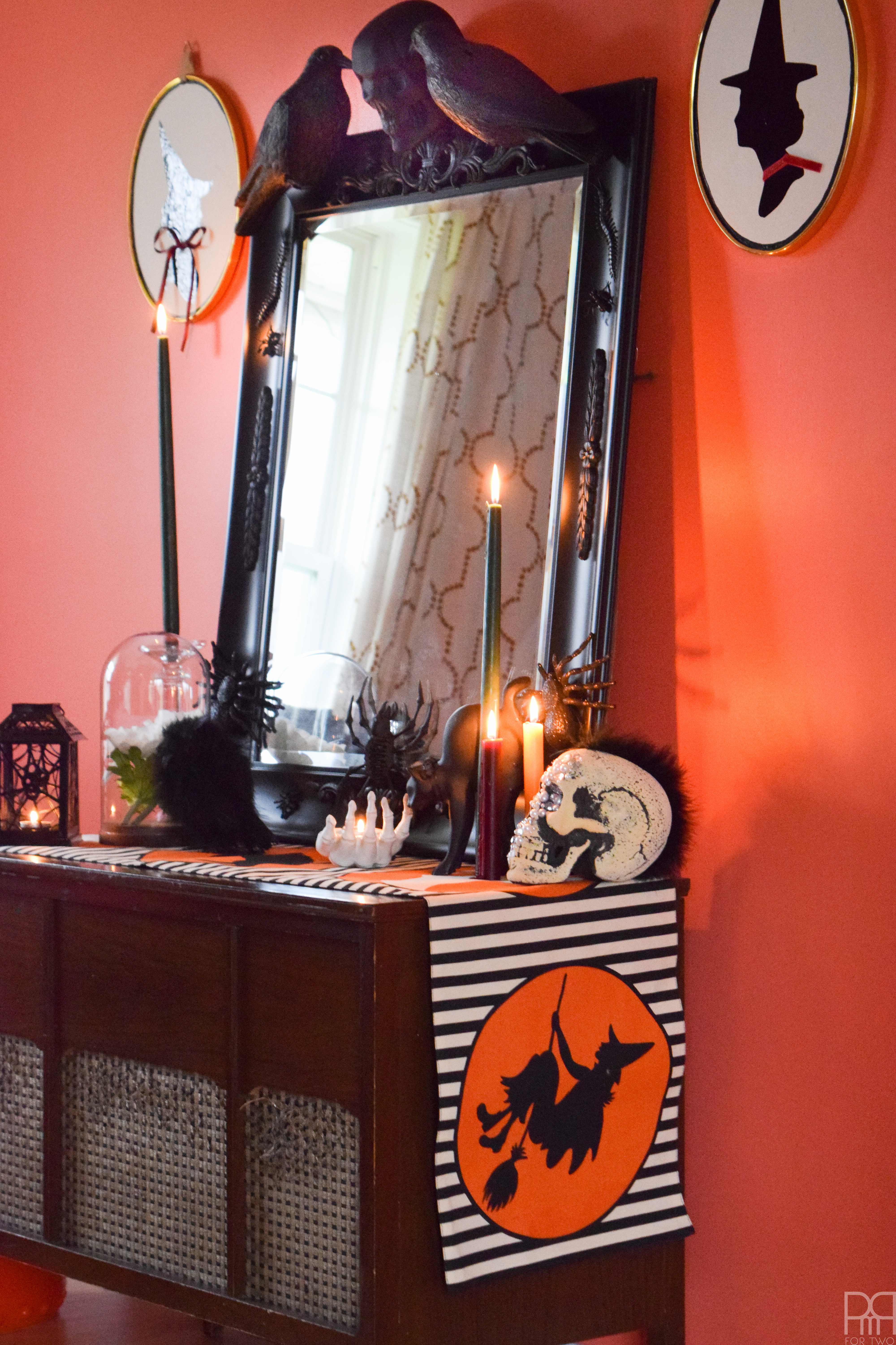 Create a show-stopping piece of Halloween Decor for your entryway using items from the dollar store and an existing mirror.