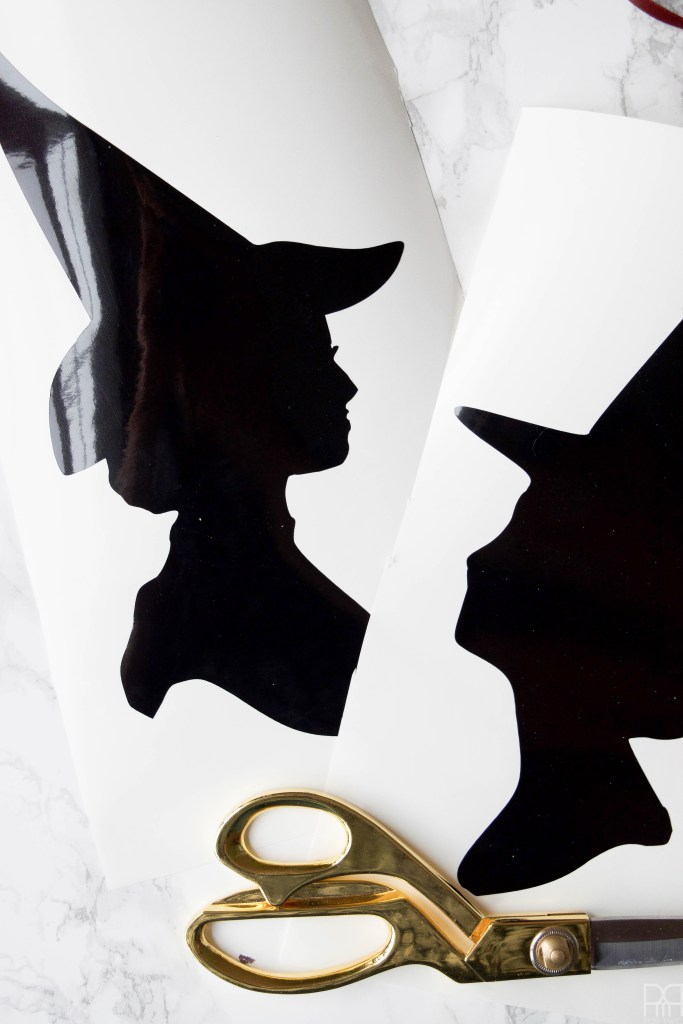 Make your own DIY Witch Silhouette Decor with your Cricut and thrifted frames. Halloween decor doesn't have to be cheesy to look good.
