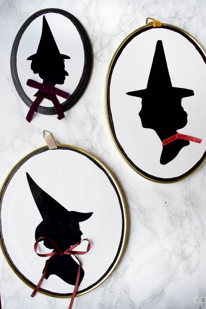 Make a DIY Witch Silhouette Decor using your Cricut and thrifted frames. Halloween decor doesn't have to be cheesy to look good.