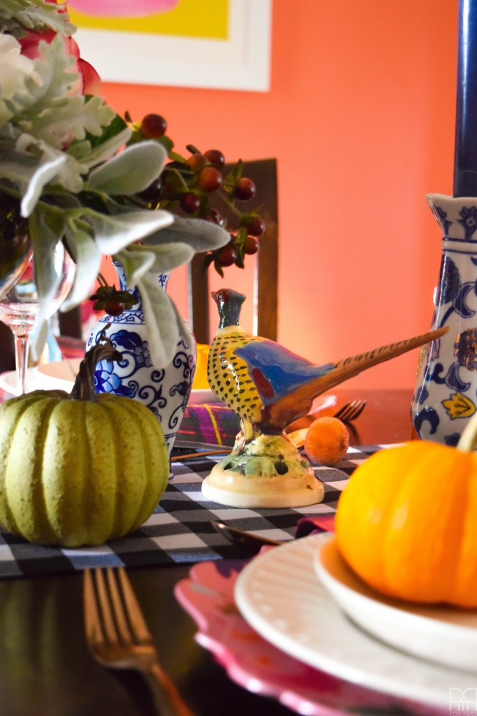 An eclectic and colourful thanksgiving tablecape that puts hearth and home and colours of all kind and bold patterns on display in a season of giving.