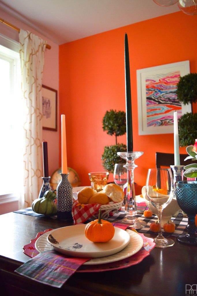 An eclectic and colourful thanksgiving tablecape that puts hearth and home, colours of all kind and bold patterns on display