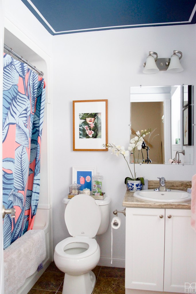 Tada! ✨ 🎩 🐰 Renter Friendly Bathroom Reveal is here after a weekend of work. We've transformed our bathroom using renter-friendly upgrades and Behr Paint to create a colourful & eclectic space that I am proud to show off, heck, I might even host a party in there
