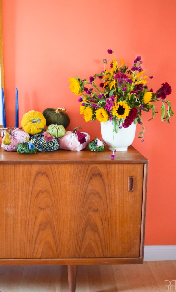 fabric pumpkins on an mcm sideboard