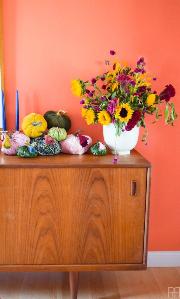 fabric pumpkins on an mcm sideboard