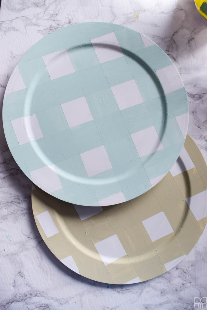 Using Americana's chalky finish paint you can cover-up ugly plastic plates and create beautiful painted plaid chargers.