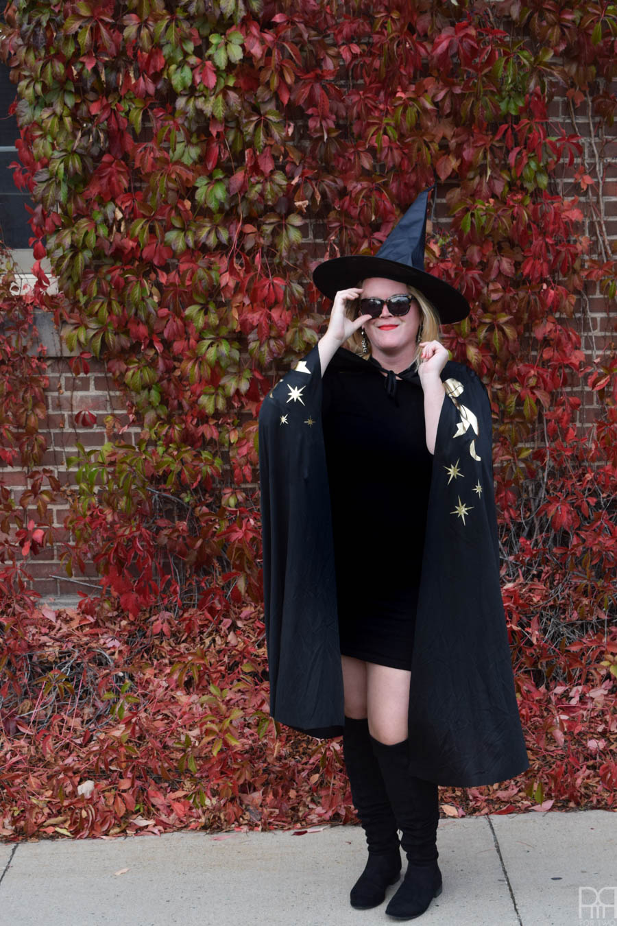 DIY with costume in front of red brick wall