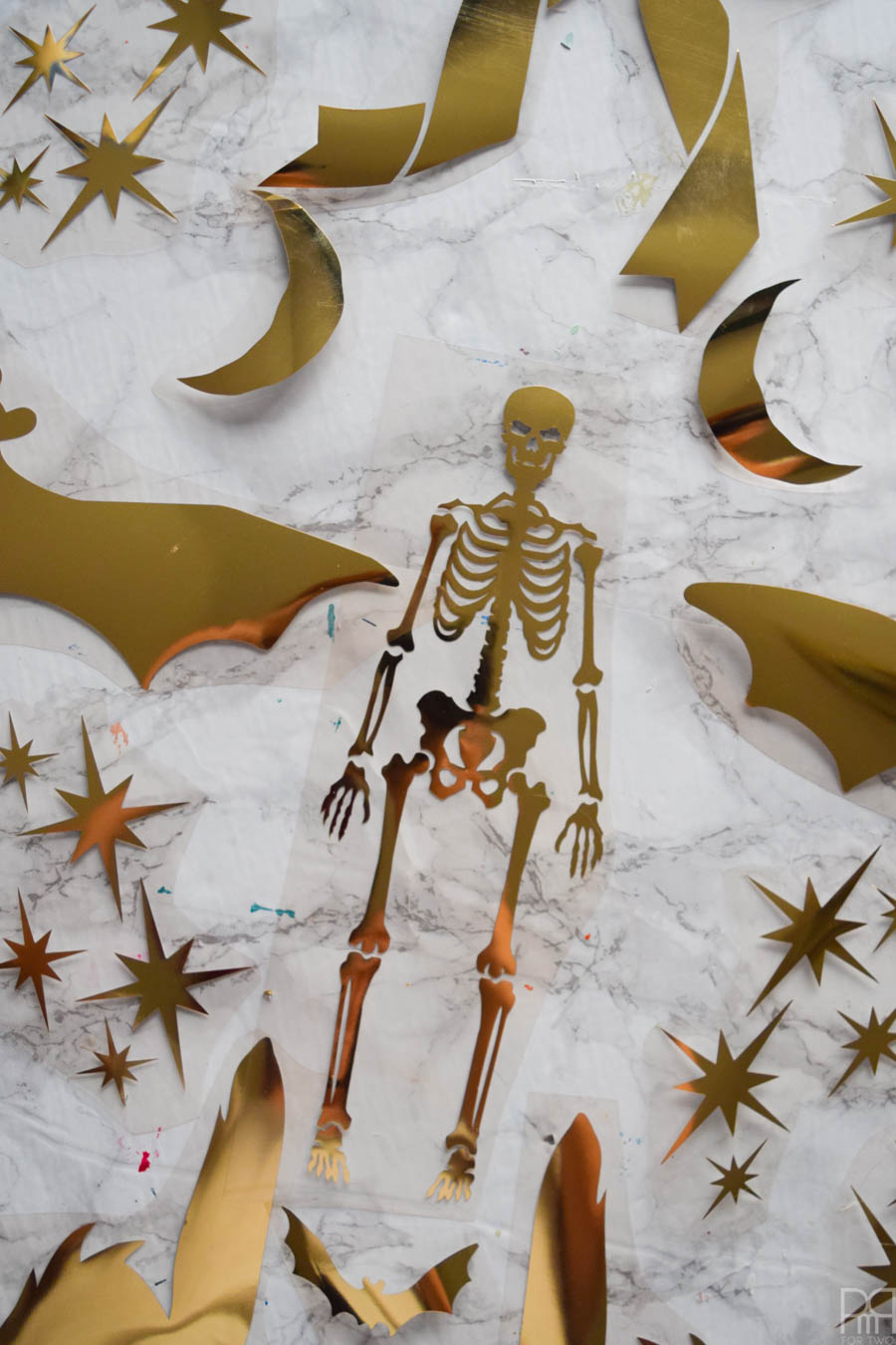 skeleton, bat and atomic starbursts cut from gold HTV