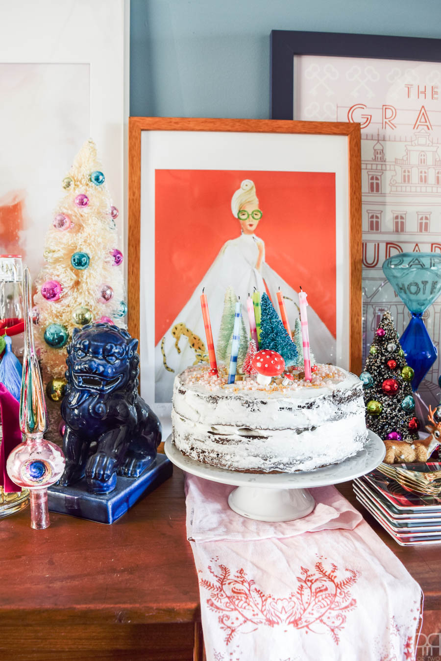 Create a colourful and curated Christmas tablescape with pops of retro and nostalgia. The look is festive and trendy without being overpowering, and my Christmas gift centerpiece is pretty darn impressive.